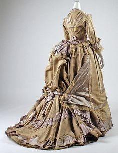 Taupe-colored silk dress (circa 1865-70).  Although these are amazing creations of skill and artistry, I have to admit that the late Victorian dress styles are least appealing to me.  SO over the top!  I'd feel buried under all that fabric and frippery!