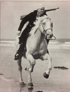 "During WWII, the Coast Guard Beach Patrol covered more than 3,700 mile of coast and employed about 24,000 men. Patrols on horseback worked in pairs, riding about 100 feet apart, usually covering a 2-mile stretch. They were call ""Sand Pounders"" and were able to cover difficult terrain quickly and efficiently. c 1945"