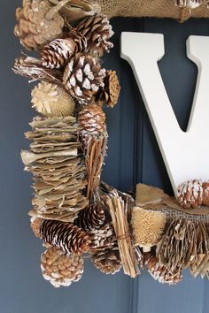 Super easy monogram winter wreath made out of pinecone garland from Michaels via Coastal Windows & Exteriors blog