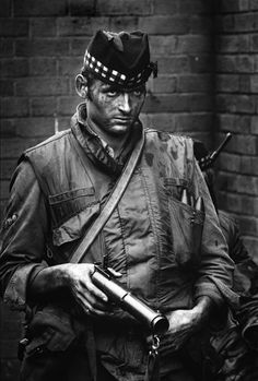 """This [British] soldier was facing a hostile crowd of youngsters and, for a moment, his expression revealed his disdain.""  Northern Ireland - 1972  (Photo by Philip Jones Griffiths)"