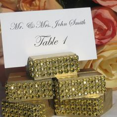 Gold Jeweled place card holders, the holder has been wrapped with a gold crystal wrap ribbon (please note: The crystal wrap does NOT include Real diamonds, crystals, or rhinestones, the gold stones ju