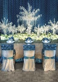 Loving this blue and silver wedding decor by The Wedding Belle. Florals by Hydrangea. Photo by Randy Coleman Photography. #wedding #crystal #blue #silver #decor #table