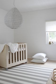 Woodnotes Big Stripe paper yarn carpet and Vista roller blind in the baby room. Harmony. Cozy. White home. Light and white. Interior design. Interior decoration. Finnish design. Design. Contemporary. Children room. Kids room. Childrenspace. Bedroom.  Asuntomessut 2106 Talo Koskela.