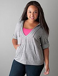 Casual chic at it comfiest, you'll reach for our French terry burnout hoodie again and again. Both timeless and trendy, this pullover is designed for layering with a deep V-neck and features a drawstring hood, double entry kangaroo pocket and 3/4 sleeves that roll with tab & snap closure. Ideal for active days or just hanging out. lanebryant.com