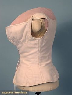 RARE WHITE LINEN CORSET, 1790-1810 October 2006 Vintage Clothing & Textile Auction New Hope, PA Fabric woven in herringbone pattern, front lacing w/ brass hooks, pair embroidered eyelets on each shoulder for tying, B 29, W 21, L 19, (lacings not original) excellent.