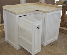 From Milestone Kitchens English Elegance Range.Custom Corner Unit with Doors and Spice Drawer.