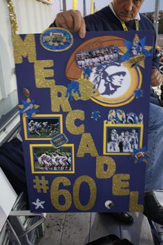 Juniors present Senior Football Players & Trainers with a Good Luck Poster