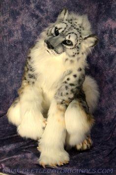 Snow leopard fursuit.