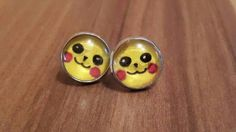 Pikachu earrings  https://www.etsy.com/uk/listing/267653493/pikachu-cabachon-stud-earrings