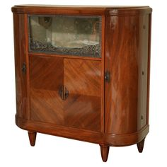 Louis Majorelle Art Deco Vitrine, France  circa 1920 - a signed Majorelle piece.Japanese inspiration. It has one pull down glass door framed in stylized iron work typical of the period.