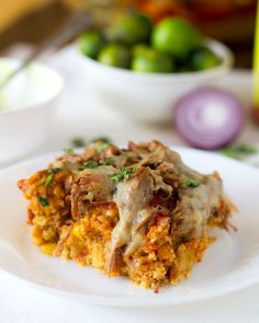 Carnitas Tamale Pie | I just love whole thing together – the melted cheese, enchilada sauce, spicy carnitas, and a sweet, mushy tamale-like crust. I like that it can be cut into squares or just scooped into a bowl. I like that it can should be sprinkled with cilantro. I like the melted white cheese. What if I told you I liked putting guacamole on this?  I just don't stand a chance against Tex-Mex gluttony right now. |  From: pinchofyum.com