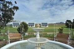 Scenic photos of vineyards, cottages, rakes and impliments at our country house in Tulbagh