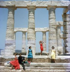 Title:Dimitris Kritsas   Caption:1961, Dimitris Kritsas, a fashionable young couturier, poses among the gleaming Doric columns of the temple to Poseidon at Sounion. (Photo by Slim Aarons/Getty Images)       Artist:Slim Aarons  Date:1961