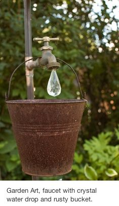 Garden Art : simple and cute. Maybe some flowers that drape over part of the bucket to add color.