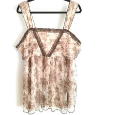 Lane Bryant Brown Lace Trimmed Chiffon Tank 24 This Lane Bryant Brown Lace Trimmed Chiffon Tank is a size 24 in good used condition. Lining is nude with floral print mesh-like layer over the top and brown lace trim. Great for a vintage or boho look. 30 inches long. Bust measures 23 inches across laying flat, measured from pit to pit, so 46 inches around. Empire waist seam. No pilling, stains, or snags. ::: Bundle 3+ items from my closet and save 30% off when you use the app's Bundle feature…