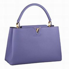 4facc447db9d Presenting the Louis Vuitton Capucines Bag. This lovely bag is part of  Louis Vuitton s 2014 Collection. It has a flap that can be worn in two  ways
