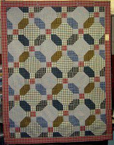 Seven Shirts to make a Quilt (a Snowball & 9-patch).  Life is a Stitch: Seven Shirts + Seven Steps = One Thrifty Quilt.  Link:  http://thethriftyquilter.blogspot.com/2009/06/seven-shirts-seven-steps-one-thrifty.html