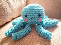 "Free Octopus pattern by Caroline Chrisco   Materials: Small amounts of ww yarn ""G"" hook 9mm safety eyes Fiberfill stuffing Embroidery threa..."