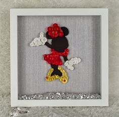 I am proud to introduce my latest addition to my Button art range ❤️❤️ Minnie Mouse ❤️❤️ Minnie is a silhouette figure, dressed with high quality buttons and finished off with tiny diamanté stones to add that extra sparkle. The bottom off the frame is decorated with acrylic