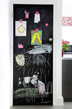 Doors don't just have to be for entering and leaving a room, why not make the most of them. Using blackboard paint on the back of the door is a great (and cheap) way of creating a notice board for you and the family! Image: Livingetc