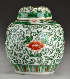 "Chinese Famille Verte Porcelain Covered Jar Having enameled decoration depicting peonies and scrolling tendrils, unmarked, measures 5.75""H, circa 1940s."
