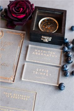 Hunger games wedding inspiration - lucite invitations - gold lettering love