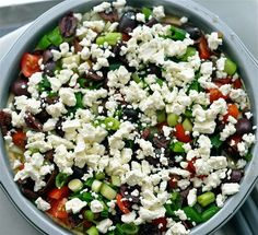 Layered Greek Dip.  We made this for a party yesterday and it was awesome!  Like all the best parts of Greek salad without the pesky lettuce.