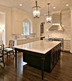 Regency styled mahogany island in a Dallas area kitchen by Isler Homes.