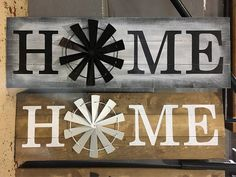 Black and white home windmill. Windmill is made of steel painted with a glossy black coating. 52 X 16.5 inches.