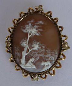 Oval Shell Cameo Plaque Brooch Depicting A Finely  Carved Full Landscape, Mounted In A 14k Gold Leaf And Scroll Form Frame With Hinged Pin On Back