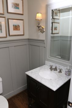 Powder room remodeling ideas powder room traditional with gray paneling gray paneling half bath