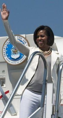 First Lady Michelle Obama waves before her departure from the airport in Mexico City.  April 15, 2010.  Getty Images