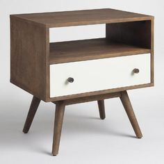 Make a mid-century-inspired statement with our end table, crafted in India of solid mango wood. Standing on conical legs, it features a white lacquer drawer and a contrasting dark walnut frame and cubby space.