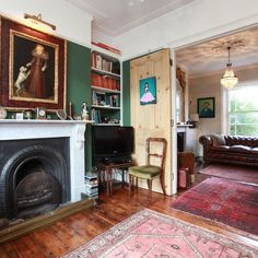 Open dining room / living room in a Victorian house in London.