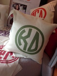 Greek Graffiti's Kappa Delta 20X20 Burlap Pillow In Olive Green http://greekgraffiti.com/collections/kappa-delta/products/kappa-delta-circle-monogram-burlap-pillow