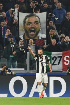 Gonzalo Higuain of Juventus celebrates after scoring the opening goal from the penalty spot during the UEFA Champions League Group H match between Juventus and Olympique Lyonnais at Juventus Stadium on November 2, 2016 in Turin, Italy.