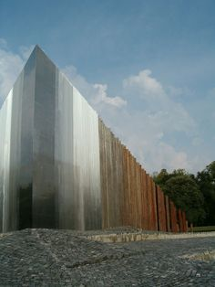Monument of the 1956 Hungarian Revolution photographed by Michiel van Raaij; This shows a gradient from individual towers of weathered steel at one end to the a single indivisible mass, a reflective blade, at the other end. Detail Architecture, Minimalist Architecture, Amazing Architecture, Contemporary Architecture, Landscape Architecture, Interior Architecture, Built Environment, Installation Art, Wabi Sabi