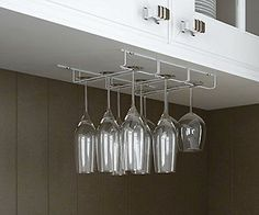 Rack and hook stemware wine glass hanger under cabinet storage bar kitchen white product description features: 1. Store and protect your delicate wine glasses, champagne flutes and other glassware with this hanging stemware rack! 2. This versatile storage rack can hold a variety of glasses and is great for entertaining. 3. Bring new function to your existing cabinets and storage. 4. Stylish, contemporary design looks great with a variety of cabinet styles 5. Can hold up to 18 glasses with…