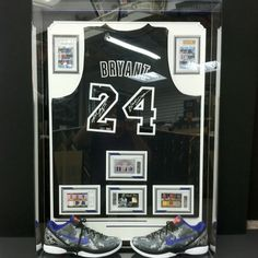 The black mamba! KOBE BRYANT display with 6 1 of 1 graded cards, auto black lakers jersey 1of 24 and a pair of Kobe 1 of 8 autographed shoes. Truly a one of a kind display from the CREATIVE PLAY !