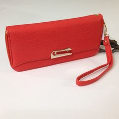 Coral Textured Faux Leather Wristlet The perfect pop of color to finish your outfit! Coral faux leather textured wristlet with gold trim. Zip top closure, credit card holders, additional compartments. 7 inch detachable wristlet. 8 x 3.5 x 1 inch. Also available in light gray. Boutique Bags Clutches & Wristlets