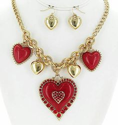 Check out this valentines necklace set in my Etsy shop https://www.etsy.com/listing/261949860/gold-and-red-hearts-charm-necklace-set