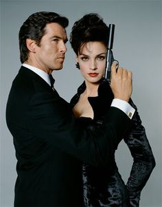 GOLDENEYE- Bond babe Famke Janssen and Pierce Brosnan.