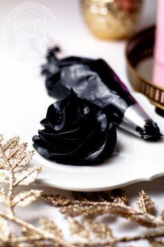 Deep black buttercream icing Put edible purple glitter in
