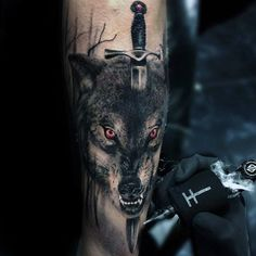 Hunt your way through ink inspiration with the top 50 best realistic wolf tattoo designs for men. Explore cool canine and manly wolf pack ink ideas. Wolf Pack Tattoo, Wolf Tattoo Forearm, Wolf Tattoo Sleeve, Geometric Wolf Tattoo, Tribal Wolf Tattoo, Small Wolf Tattoo, Tattoo Wolf, Tattoo Art, Wolf Tattoo Design