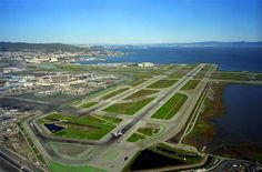 Photo: SFO Runways and !R with Terminal. San Francisco and Oakland in background. Vegas, Earth View, Air Traffic Control, Aviation Industry, History Of Photography, San Francisco California, Commercial Aircraft, International Airport, Military Aircraft
