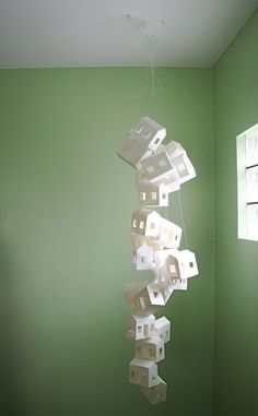 Paper House Mobile. $150.00, via Etsy.  bet it takes forever, but totally worth trying to DIY