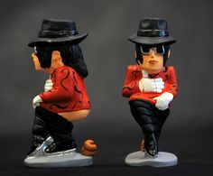 A ceramic figurine of Michael Jackson defecating is seen at a market in Barcelona, Spain. Caganers - statuettes of well-known people defecating - are a Christmas tradition in Catalonia, dating back to the 18th century. Catalonians hide caganers in Christmas Nativity scenes and invite friends to find them. The figures symbolise fertilisation, hope and prosperity for the coming year