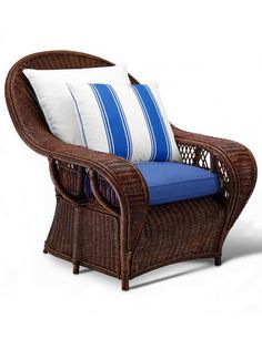 "Conservatory Garden wicker lounge chair, offered in white, black, or mahogany (shown) wicker, with cushions available in a variety of fabrics, leathers, or c.o.m. (pictured here in Velasquez Linen Stripe fabric by Ralph Lauren Home), 42.25"" h. 35.5"" w. x 43"" d., from $4,275"