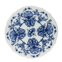 The Babele collection is glazed white porcelain with elegant and wavy edges, each hand-drawn with blue flowers and interlacing vines.