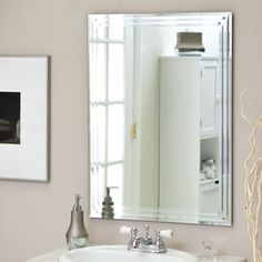 Décor Wonderland Frameless Tri Bevel Wall Mirror - 23.5W x 31.5H in. - The Frameless Tri Bevel Wall Mirror brings contemporary sophistication to your home. This stunning rectangular mirror is sure to add elegance to any w...